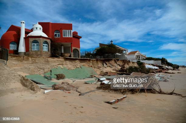 Damaged houses are pictured on March 7 2018 en El Portil near Huelva southern Spain after Storm Emma brought rounds of heavy rain and wind / AFP...