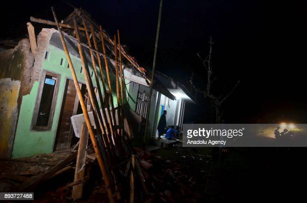 Damaged houses are seen after an earthquake recorded at 73 magnitude on the Richter scale in Sumelap village Tasikmalaya West Java Indonesia on...