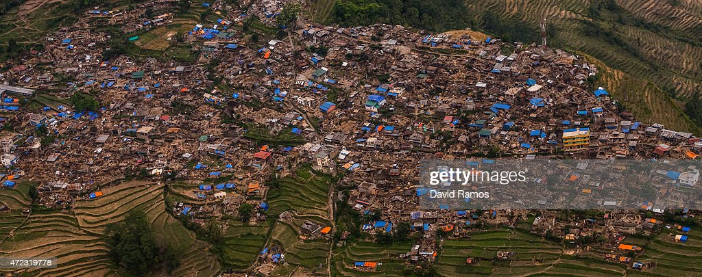 Damaged houses are seen from an Indian Helicopter on May 6, 2015 in Barpak, Nepal. A major 7.9 earthquake hit Kathmandu mid-day on Saturday 25th April, and was followed by multiple aftershocks that triggered avalanches on Mt. Everest that buried mountain climbers in their base camps. Many houses, buildings and temples in the capital were destroyed during the earthquake, leaving over 7000 dead and many more trapped under the debris as emergency rescue workers attempt to clear debris and find survivors. Regular aftershocks have hampered recovery missions as locals, officials and aid workers attempt to recover bodies from the rubble.
