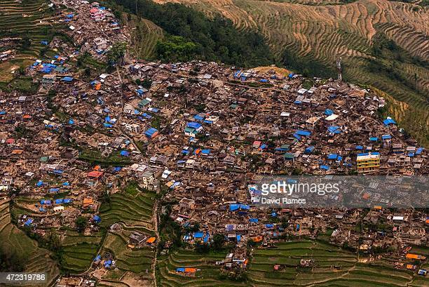 Damaged houses are seen from an Indian Helicopter on May 6, 2015 in Barpak, Nepal. A major 7.9 earthquake hit Kathmandu mid-day on Saturday 25th...