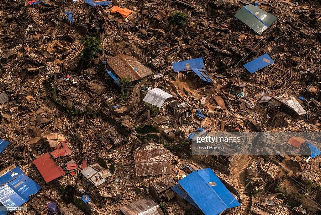 Damaged houses are seen from an Indian Helicopter on May 6, 2015 in Khanigaun, Nepal. A major 7.9 earthquake hit Kathmandu mid-day on Saturday 25th April, and was followed by multiple aftershocks that triggered avalanches on Mt. Everest that buried mountain climbers in their base camps. Many houses, buildings and temples in the capital were destroyed during the earthquake, leaving over 7000 dead and many more trapped under the debris as emergency rescue workers attempt to clear debris and find survivors. Regular aftershocks have hampered recovery missions as locals, officials and aid workers attempt to recover bodies from the rubble.
