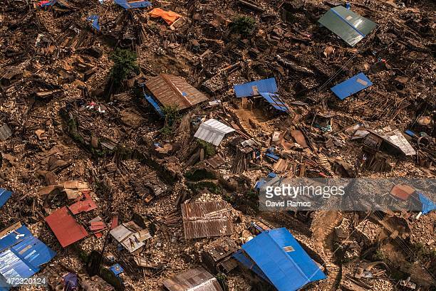 Damaged houses are seen from an Indian Helicopter on May 6 2015 in Khanigaun Nepal A major 79 earthquake hit Kathmandu midday on Saturday 25th April...