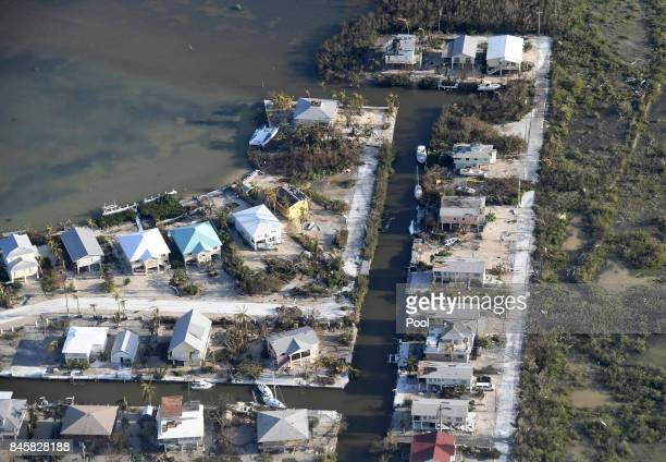 Damaged houses are shown in the aftermath of Hurricane Irma on September 11 2017 over the Florida Keys Florida