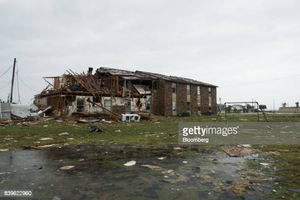 A damaged housing complex stands after Hurricane Harvey hit Rockport Texas US on Saturday Aug 26 2017 As Harvey's winds die down trouble for Texas...