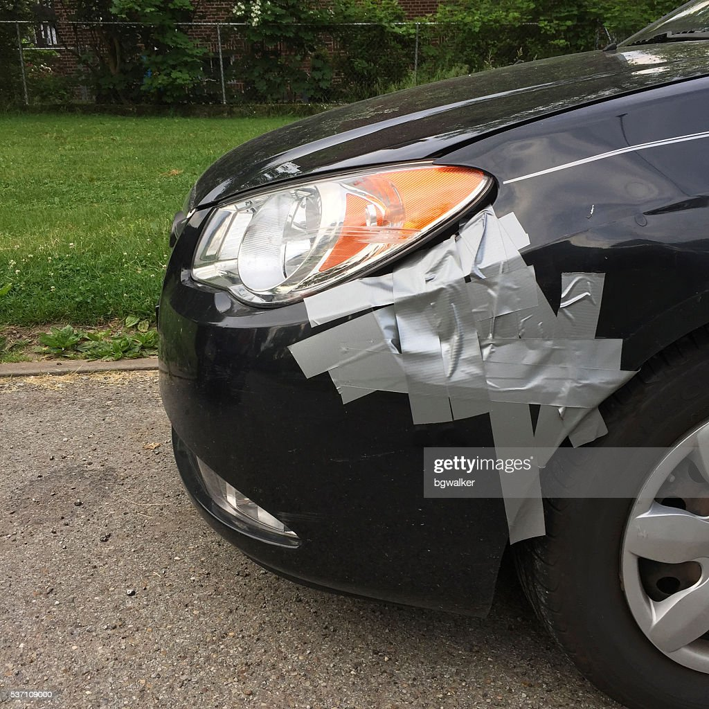 Damaged Hyundai with Duct Tape : Stock Photo