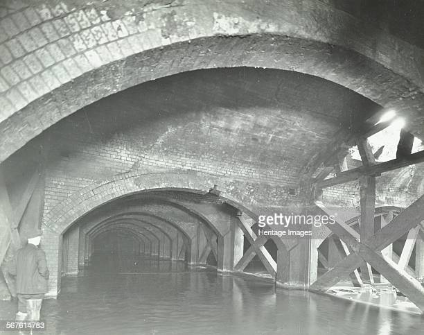 Damaged interior of the underground reservoir Beckton Sewage Works London 1938 Struts supporting a collapsing arch with part of the roof missing The...