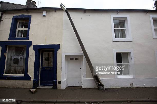 Damaged lamp post stands as flood water recedes and the big clean up of debris and damage begins on November 21, 2009 in Cockermouth, United Kingdom....