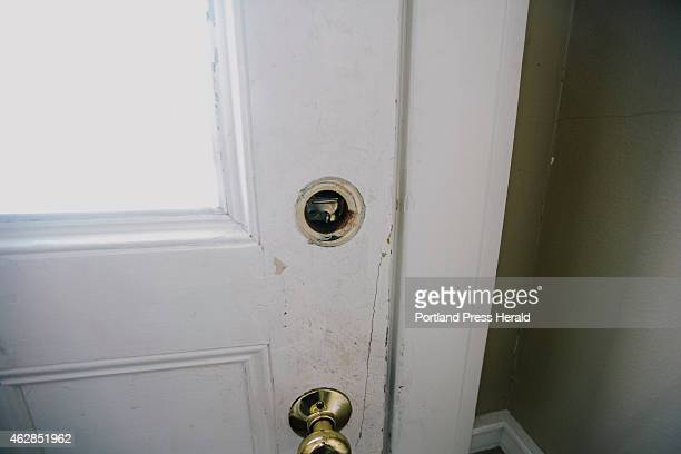 A damaged lock on the front door of 188 Dartmouth Street which has received accounts of nontenant squatters and unsafe conditions in Portland ME on...