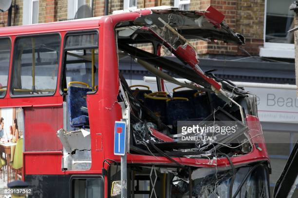 A damaged London bus is pictured at the scene of an accident after it crashed into a shop on a busy street in southwest London on August 10 2017 A...