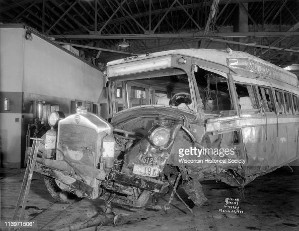 Damaged Northland Greyhound bus No 695, left front view, in