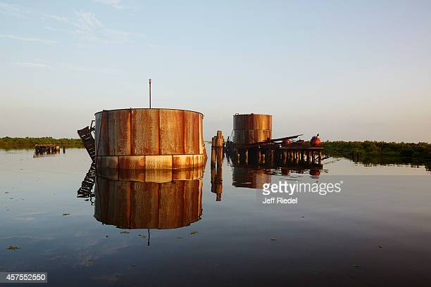 A damaged oil facility is photographed for New York Times Magazine on August 31 2014 near Lafitte Louisiana PUBLISHED IMAGE