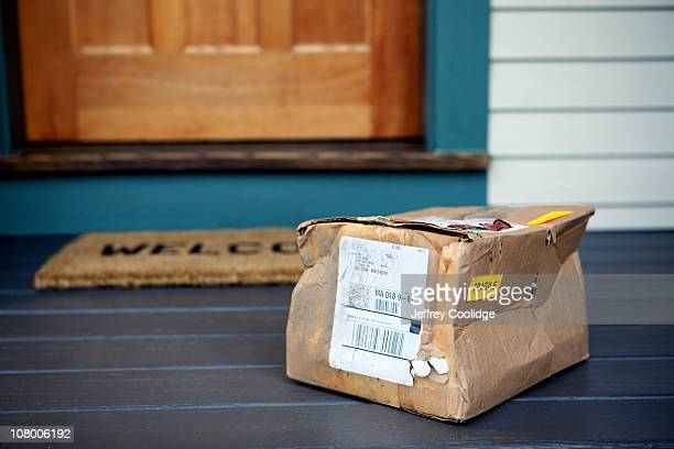 damaged package on porch - beaten up stock pictures, royalty-free photos & images