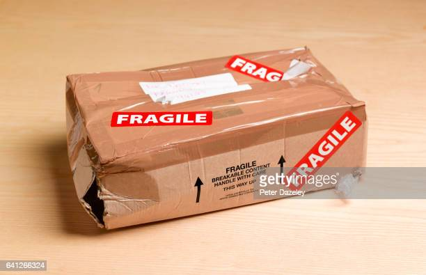 damaged package - beaten up stock pictures, royalty-free photos & images