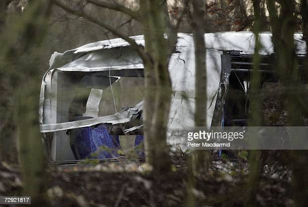 A damaged passenger coach sits near the M25 motorway awating recovery on January 4 2007 in London Two people were killed and six trapped when the...