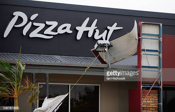 A damaged 'Pizza Hut' shop is seen on February 3 2011 in Townsville Australia So far no deaths or serious injuriees have been reported following...