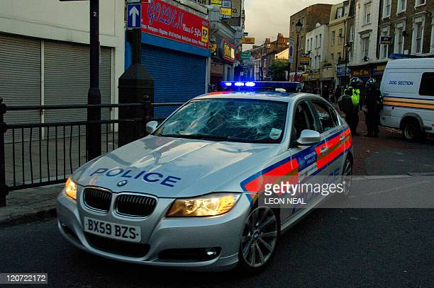 A damaged police car is driven through the police line in Hackney north London on 8 August 2011 Now in it's third night of unrest London has seen...