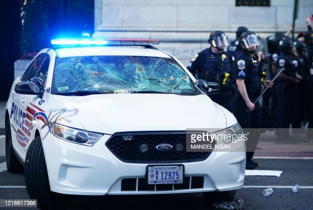 Damaged police car is seen at 15h and H Street in Washington, DC on May 31, 2020 during protests against the death of George Floyd. - Thousands of...