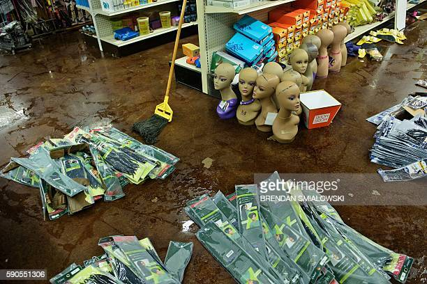 Damaged products are seen at Jasmine's Beauty Supply following the floods on August 16, 2016 in Baton Rouge, Louisiana. The expanding flood zone...