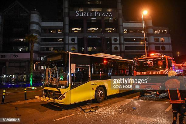 A damaged public bus is seen at the site where a car bomb exploded near the stadium of football club Besiktas in central Istanbul on December 10 2016...