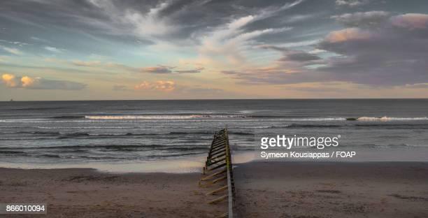Damaged railing on beach