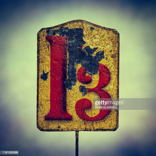 damaged red number 13 - bad luck stock pictures, royalty-free photos & images
