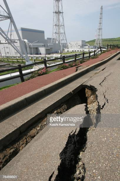 Damaged road and pavement leading to the number three nuclear power generation unit where smoke was seen spewing is pictured at the Tokyo Electric...