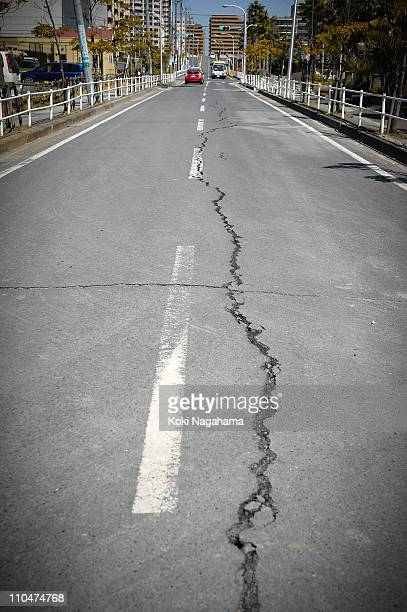 A damaged road due to the the 90 magnitude earthquake is seen on March 19 2011 in Urayasu Chiba Japan The reclaimed area at Tokyo Bay also suffered...