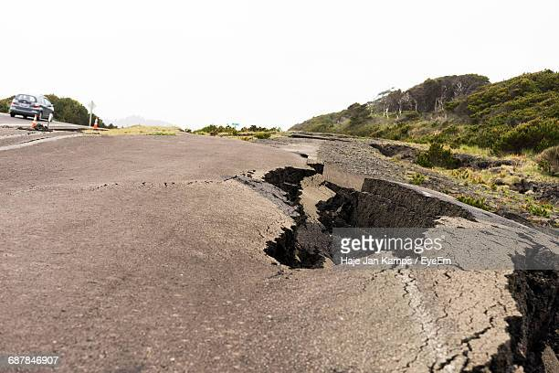 Damaged Road During Earthquake Against Sky