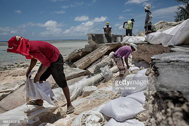 Damaged roads due to the flooding in Kirbati Tarawa's single paved road has collapsed because of the flooding from the sea The people of Kiribati are...