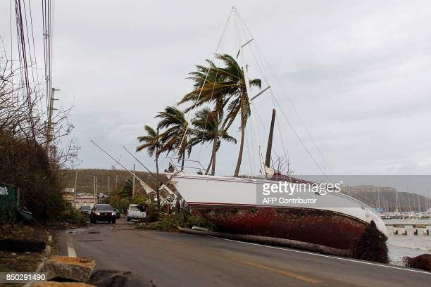A damaged sail boat washed ashore is seen after the area was hit by Hurricane Maria in Fajardo Puerto Rico on September 20 2017 Maria made landfall...