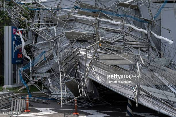 Damaged scaffolding is seen at the construction site of a parking garage at Haneda Airport following the passage of Typhoon Faxai on September 09...