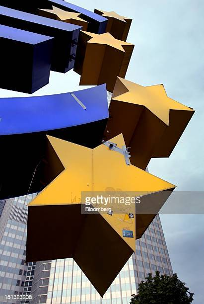 Damaged section of the euro sign sculpture is seen covered in repair tape as it sits outside the European Central Bank in Frankfurt, Germany, on...