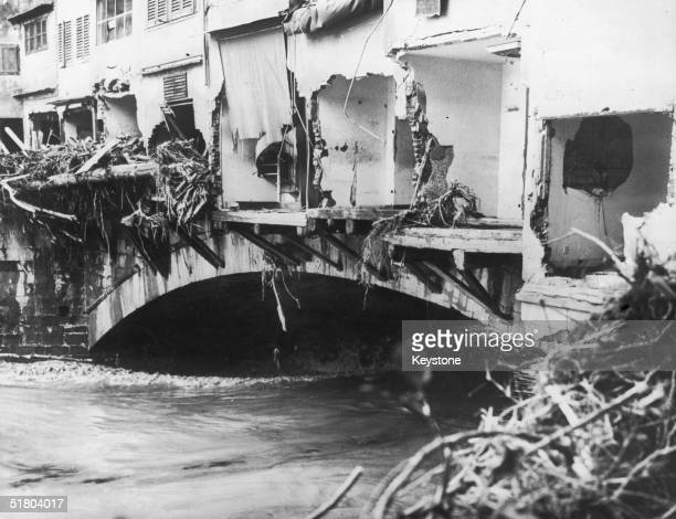 Damaged shops on the Ponte Vecchio in Florence after the Arno river burst its banks, 9th November 1966.