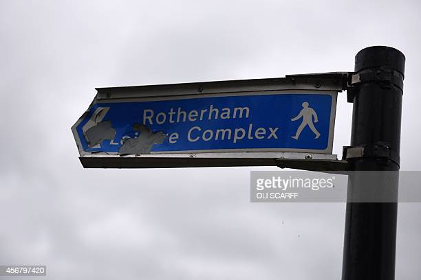 A damaged sign directing pedestrians to 'Rotherham Leisure Complex' is pictured near the town centre in Rotherham South Yorkshire North England on...