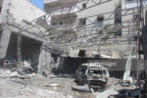 A damaged site is seen after airstrikes hit residential areas of Jisr alShughur in the northwestern Idlib province which is part of the deescalation...