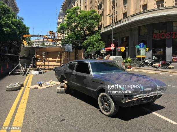 damaged sports car in film set in the street - regression film stock pictures, royalty-free photos & images