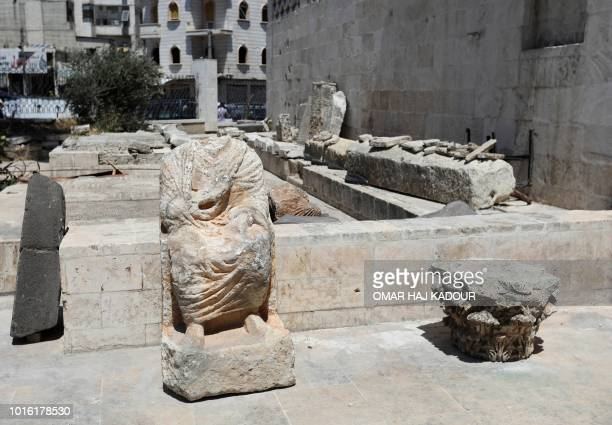 Damaged statues stand at the Idlib Museum after it reopened on August 13 2018 in the northern Syrian city of Idlib An antiquities museum in Syria's...
