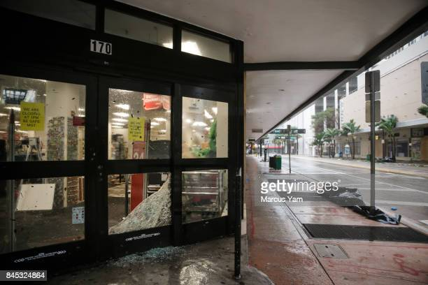 Damaged storefronts as the winds from the passing Hurricane Irma bears down the streets in downtown Miami Fla on Sept 10 2017