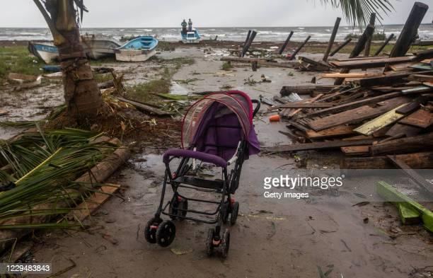Damaged stroller is seen between debris after the devastating passage of the hurricane Eta on November 5, 2020 in Puerto Cabezas, Nicaragua Eta made...