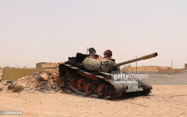 """Damaged tank is seen after clashes as Libyan Army make preparations at Ebu Gireyn and Viske regions within their operation named """"Path of Victory""""..."""