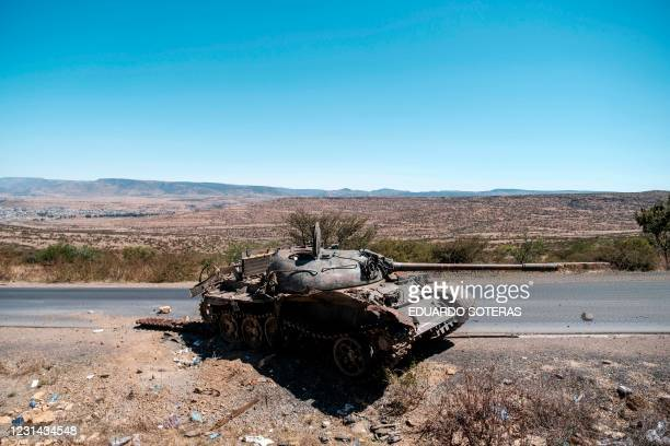Damaged tank stands on a road north of Mekele, the capital of Tigray on February 26, 2021. - Tigray has been the theater of fighting since early...