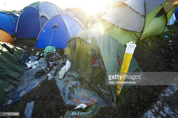 A damaged tent in the campsite during the third day of Glastonbury Festival 2011 at Worthy Farm on June 25 2011 in Glastonbury United Kingdom