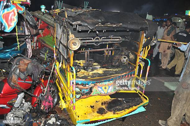A damaged threewheeler auto rickshaw and a motorcycle are seen at the site of blast in Multan district of Punjab province in Pakistan on September 13...