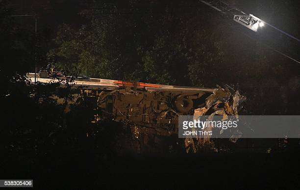 A damaged train is seen following a collision between a goods train and a passenger train on June 5 2016 near SaintGeorgessurMeuse Belgium At least...
