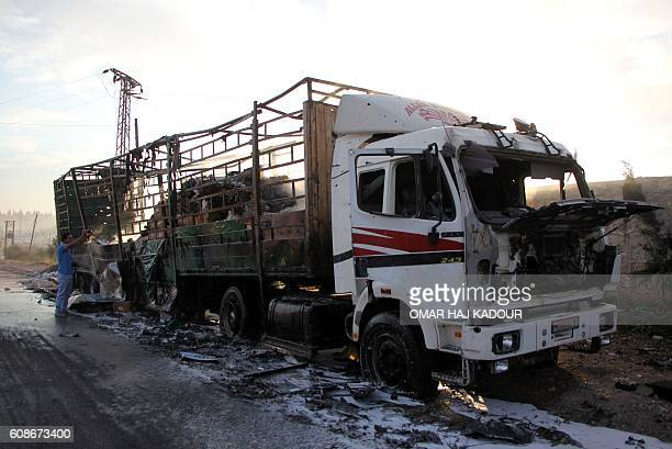 A damaged truck carrying aid is seen on the side of the road in the town of Orum alKubra on the western outskirts of the northern Syrian city of...