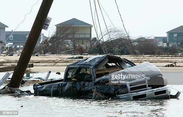 A damaged truck lies in high water caused by Hurricane Ike September 17 2008 in Crystal Beach Texas Hurricane Ike caused widespread damage and power...