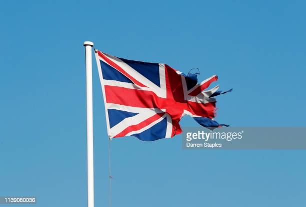 A damaged Union flag flies above a business premises on March 29 2019 in Boston England The town of Boston in Lincolnshire voted with a 75% majority...