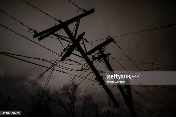 Damaged utility poles and lines hang above Underwood St on March 3 2020 in Nashville Tennessee A tornado passed through Nashville just after midnight...