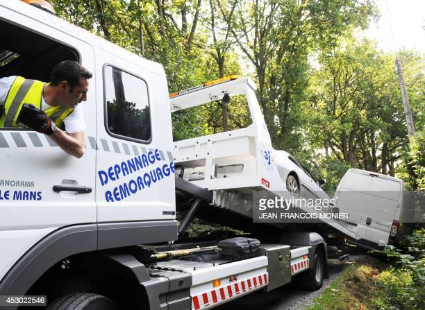 A damaged van is towed by a breakdown mechanic on August 1 2014 in La SuzesurSarthe western France Every year around 15 000 vehicles are repaired on...