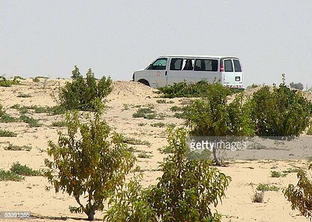 Damaged van remains on the roadside after two Canadian women peacekeepers from the Multinational Forces were wounded 15 August 2005 in a bomb blast...